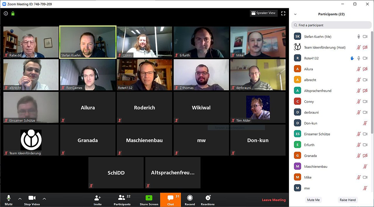 A screenshot of a large Zoom conference call in gallery mode, showing the video of many different participants.