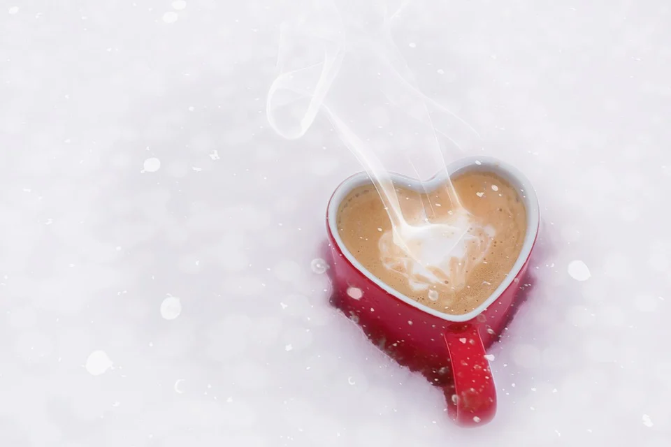 a heart shape cup with cooffe