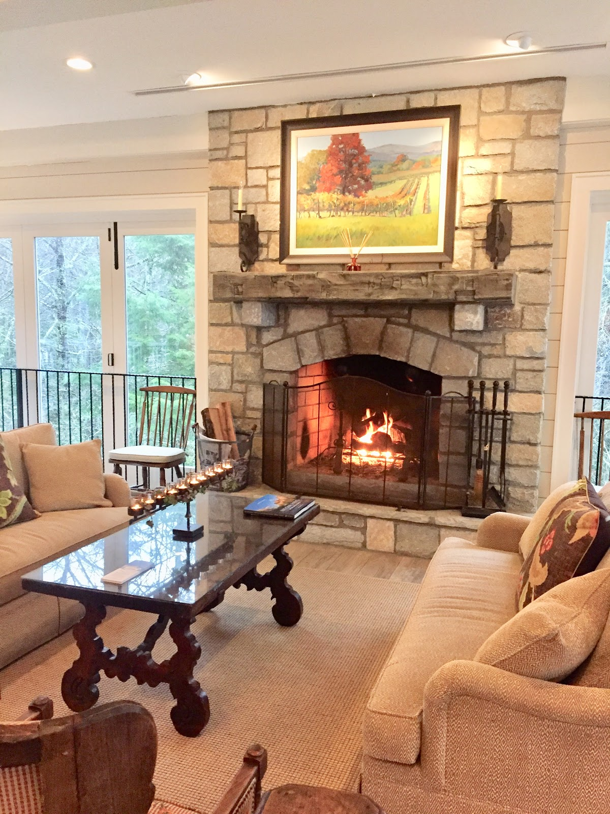 Stone Fireplace Burning With Screen