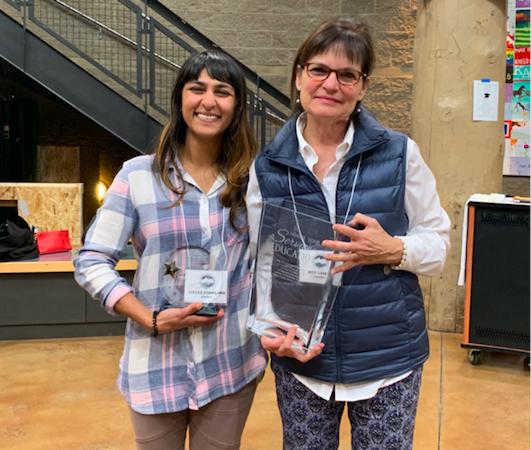 Teacher of the Year, Sheena Dhamsania and Staff of the Year, Joyce Sawczuk