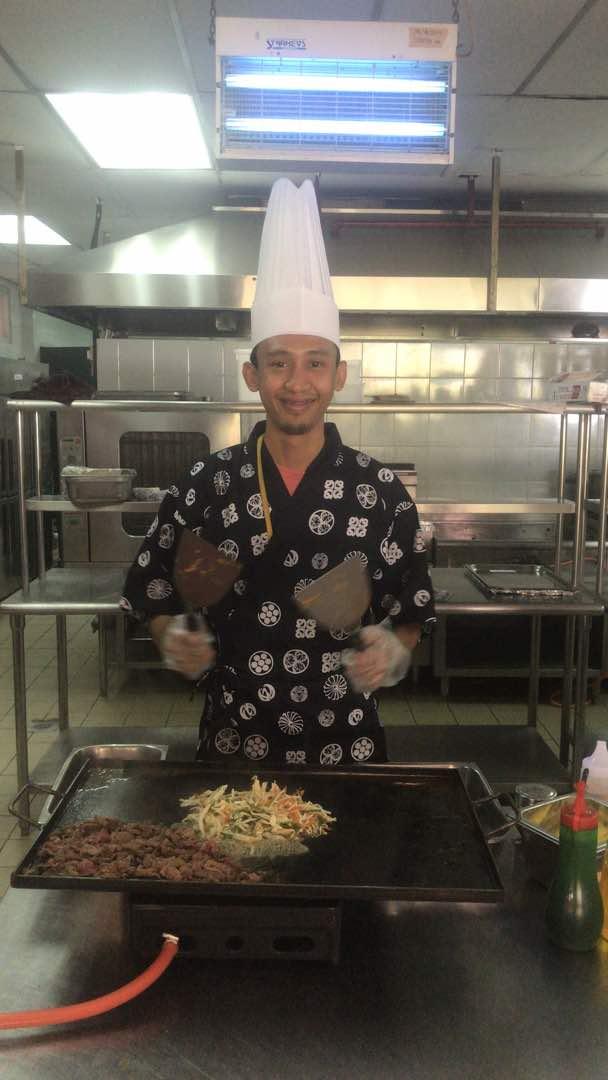 Chef Izzat cooking the yakitori chicken