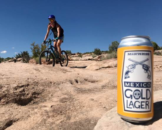 April biking near Moab with a lager in the foreground