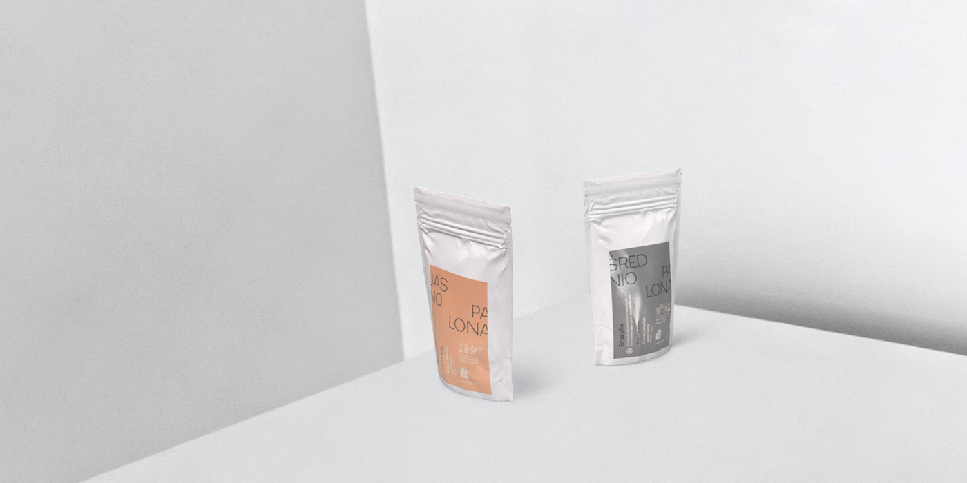 Two standing packs of coffee on a set composed of shades of white.