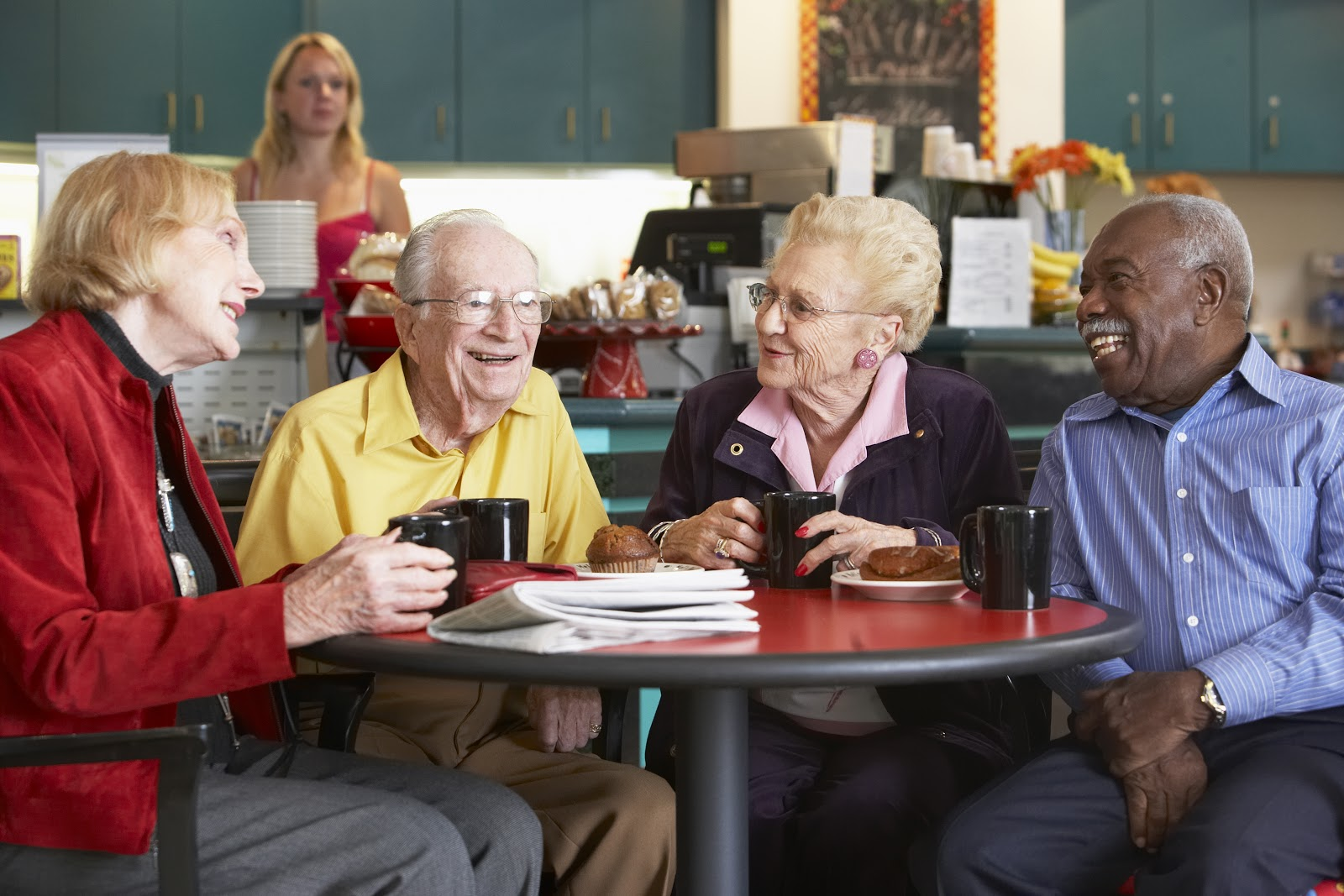 A group of elderly people enjoying a warm beverage