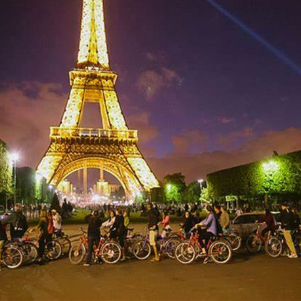 Tourists on cycles in front of the Eiffel Tower