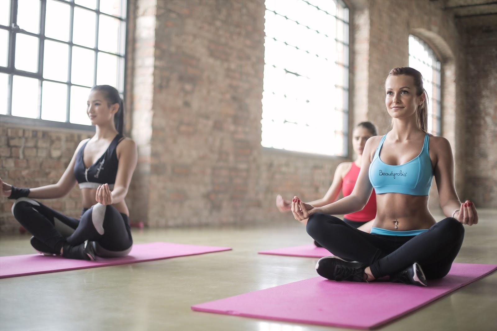 three women in a yoga studio