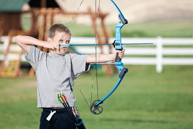 small boy practicing archery