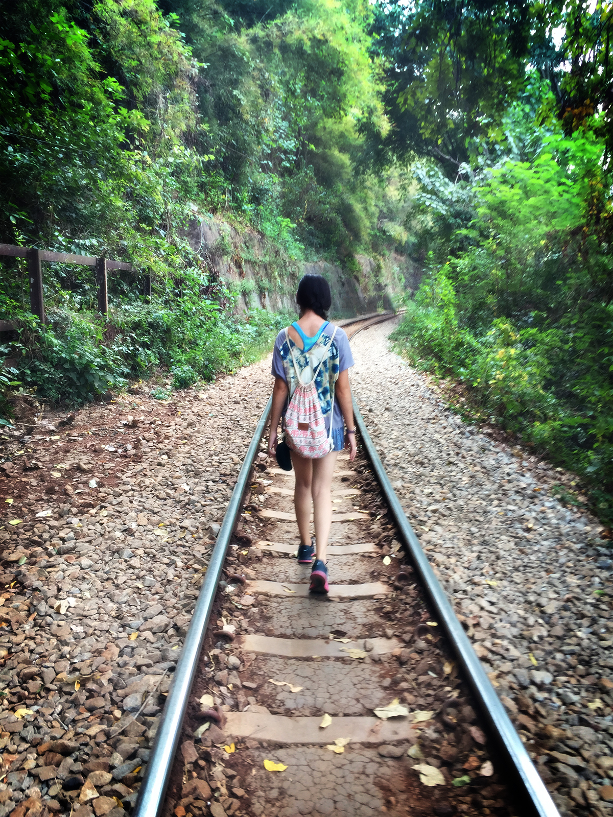 Stefanie walking down the train tracks.
