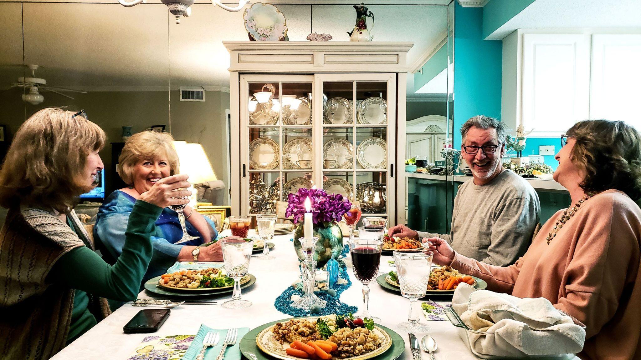 4-friends-enjoying-conversation-over-dinner