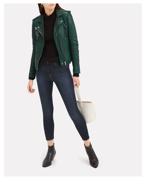 girl in a ribbed sweater anda green petite leather jacket