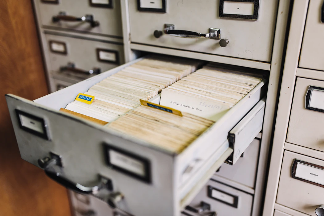 a filing cabinet filled with paper files