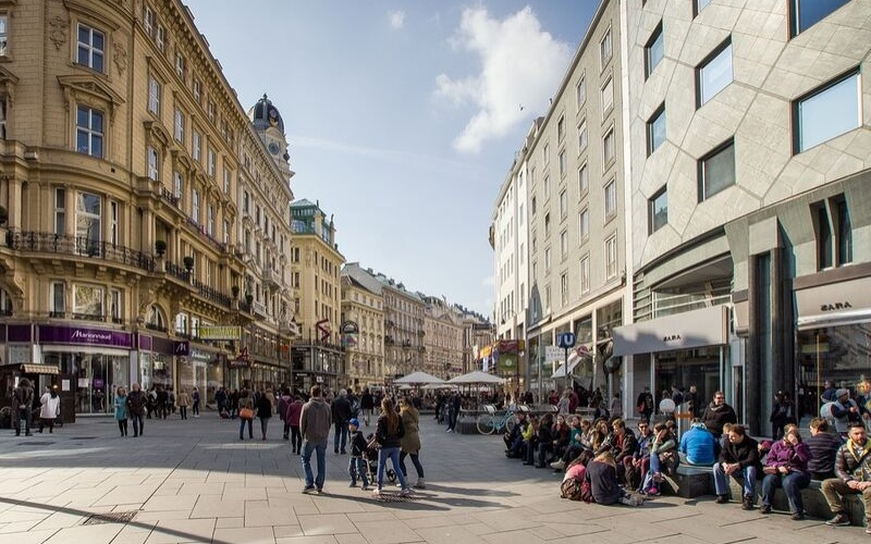 Street in Vienna with pedestrians and people watchers