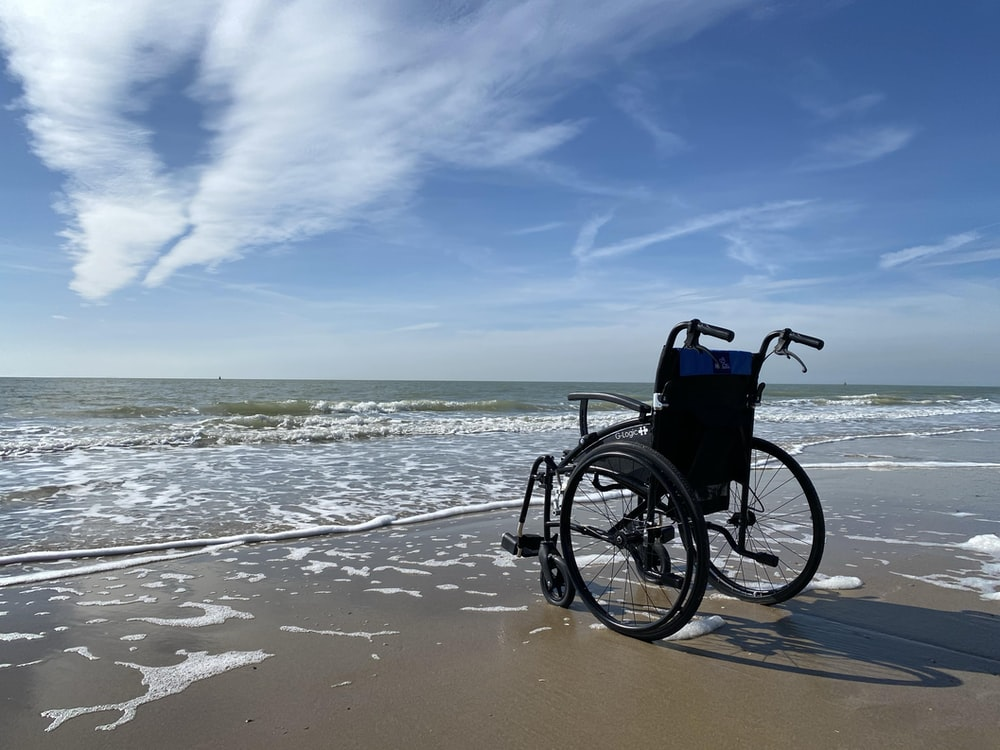 black and gray wheelchair on beach during daytime