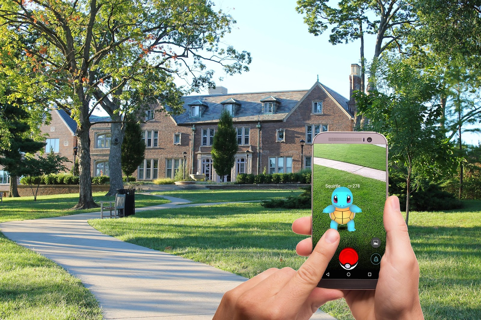 hands of a person using a smartphone to play Pokémon GO in an upscale neighborhood