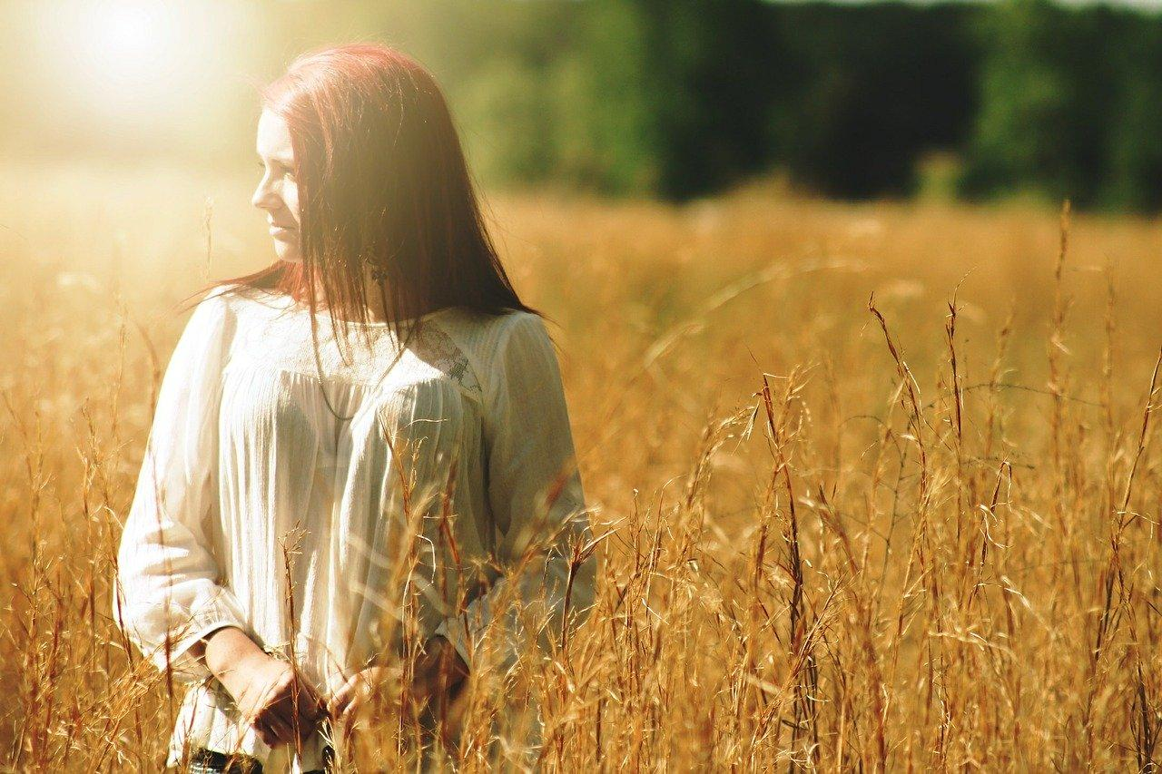 young woman in golden field