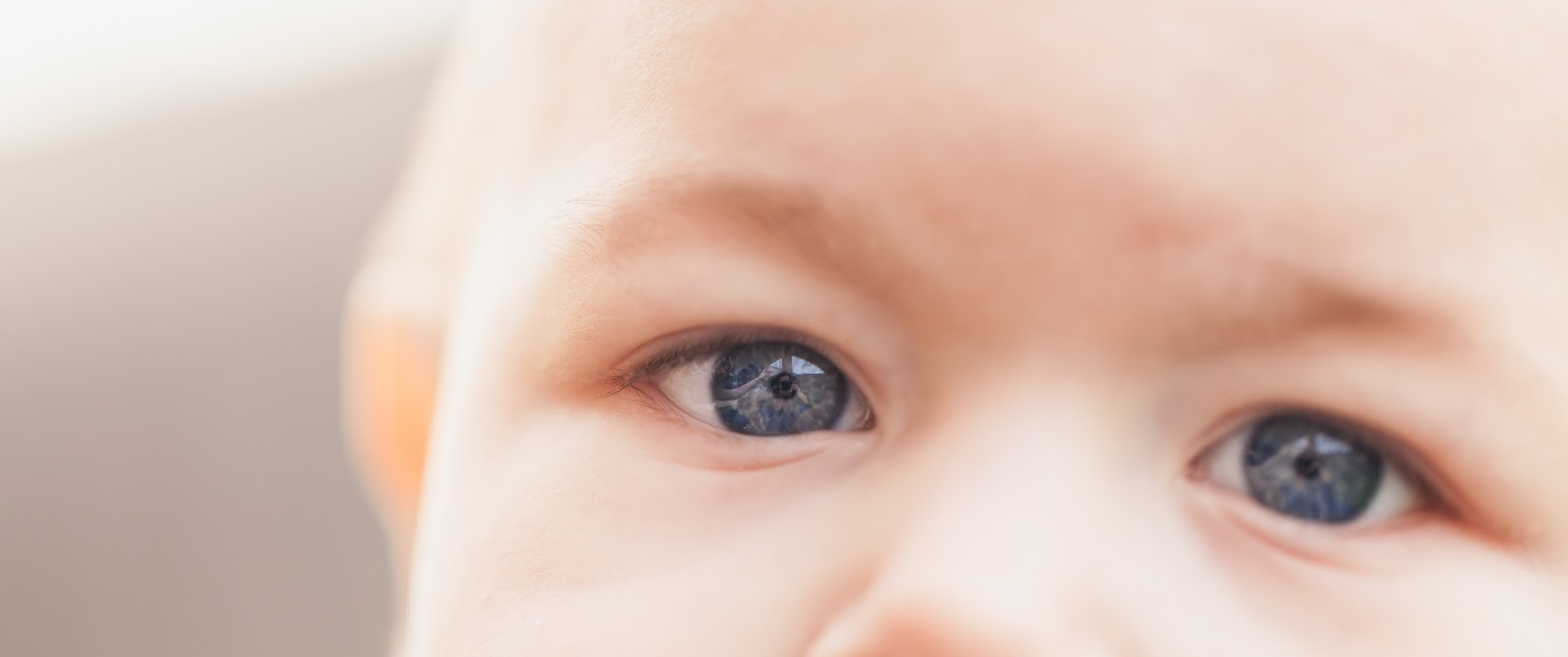 close up of baby with blue eyes