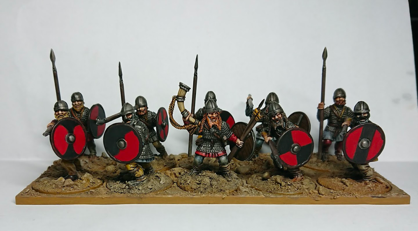 A small unit of Viking warriors, carrying shields and spears