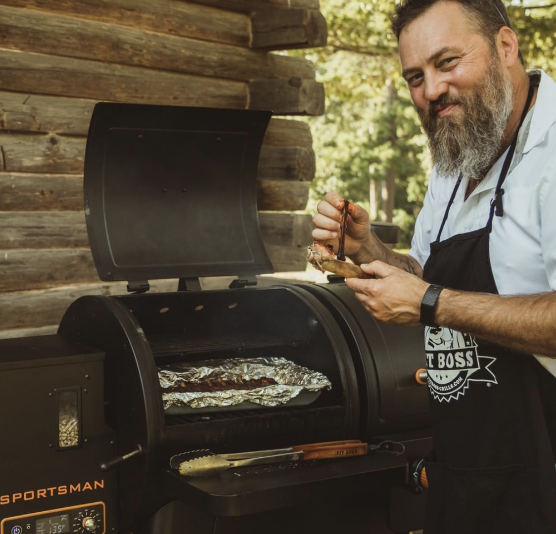 Reality TV Star Willie Robertson cooking on the BBQ