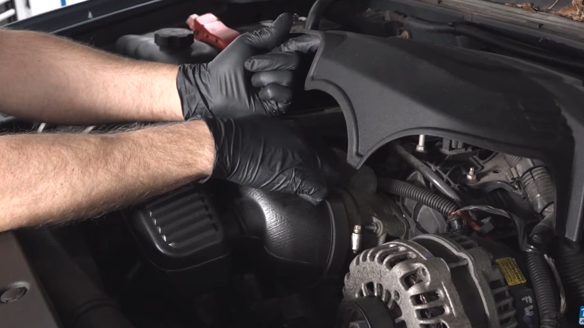Mechanic pointing to a throttle body