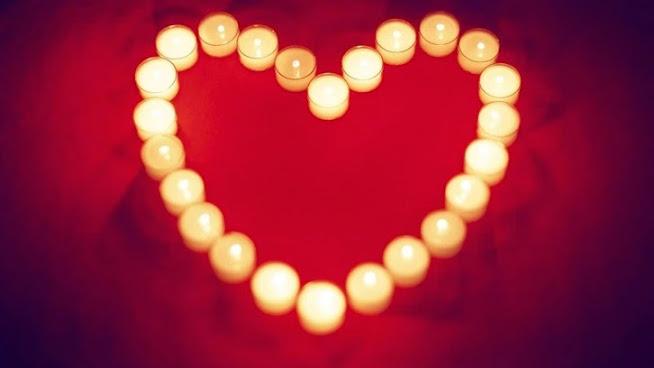 صور عيد الحب 2018 صورة قلب من الشموع المضيئة احتفالا بالفالنتين داي 14 فبراير