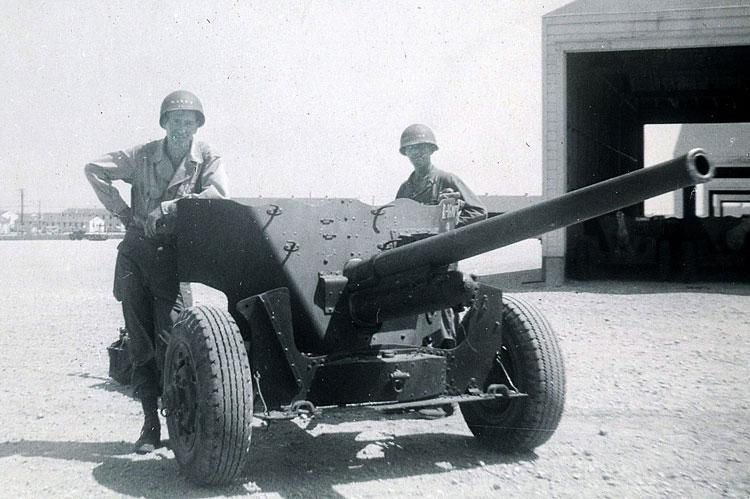Joe (at right) next to 57mm anti-tank gun