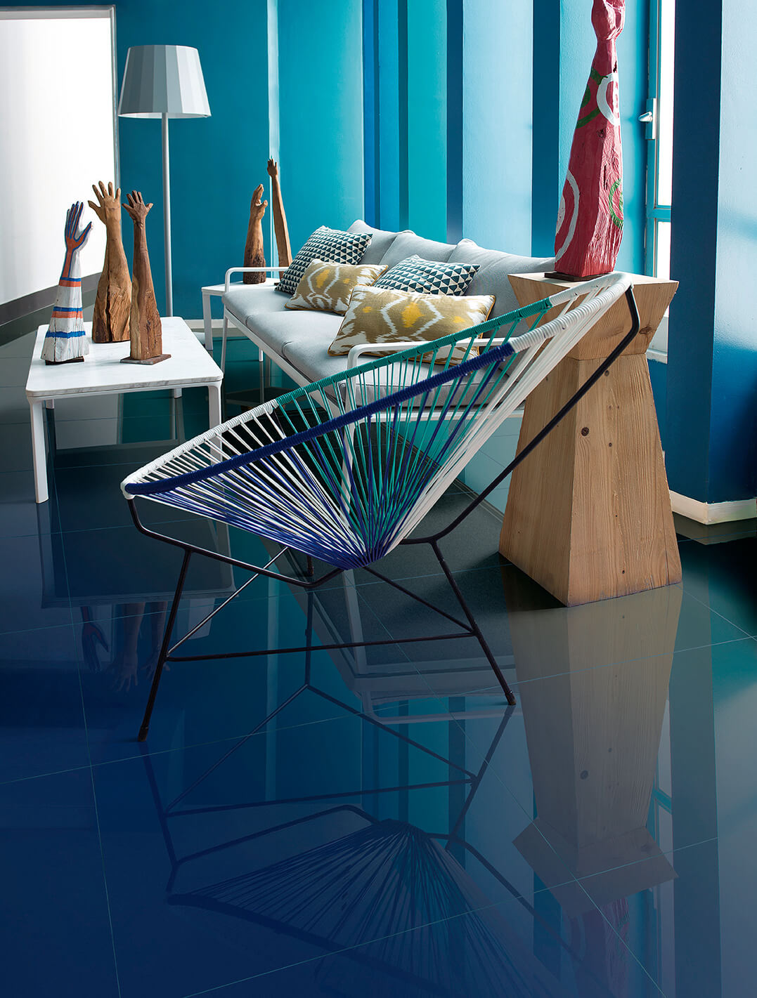 Living room with reflective blue tile flooring