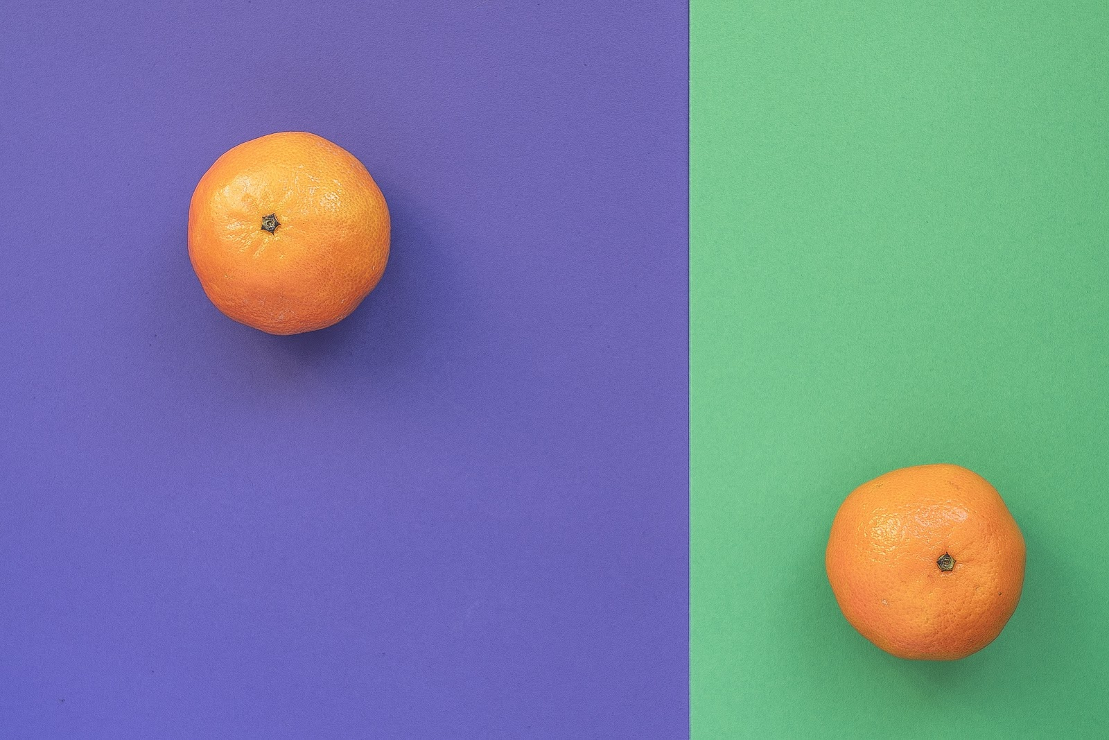 Two oranges are separated into differently colored rectangular areas.