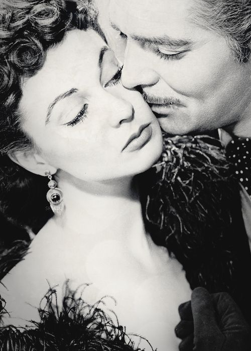 "Clark Gable and Vivien Leigh in a publicity still for ""Gone With The Wind"", 1939.:"