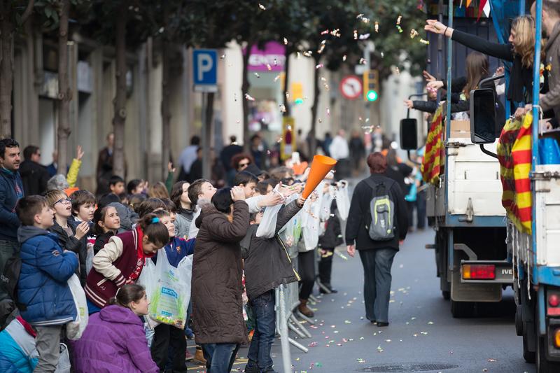 People Giving Out Caramels During Sant Medir festival