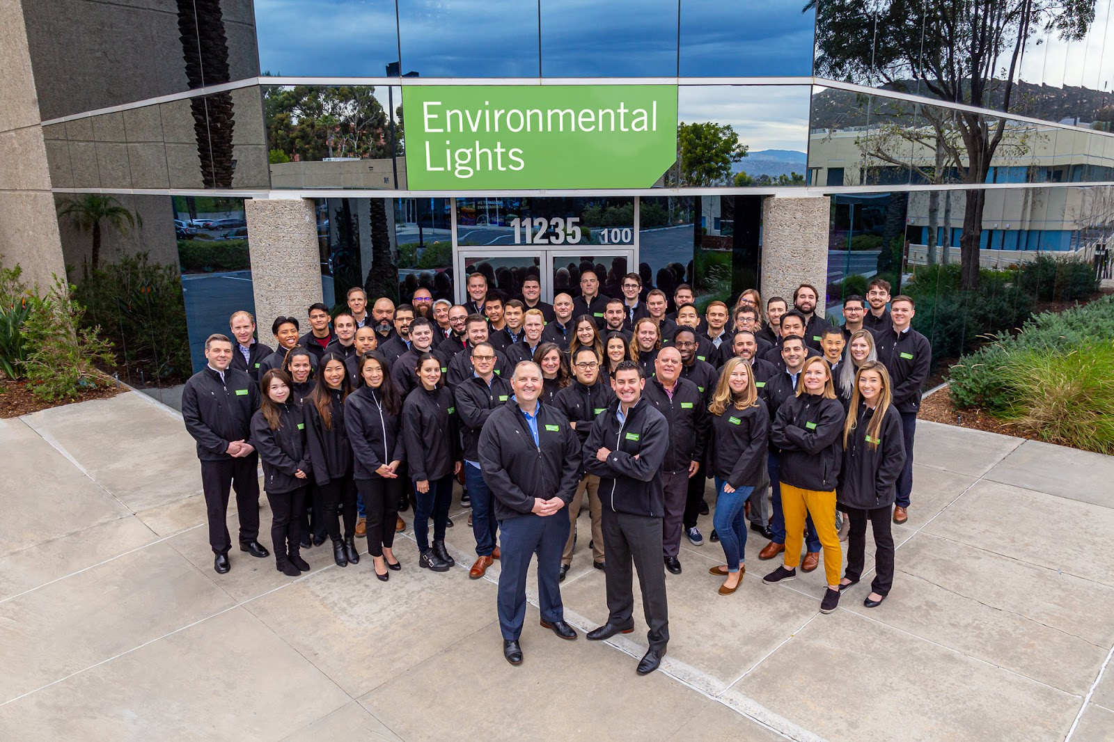 Environmental Lights' team in front of its office