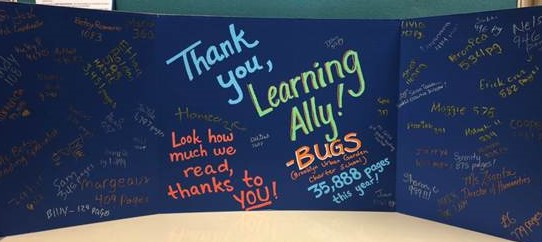 Large black card (science fair display size) with colorful message thanking Learning Ally and smaller messages from students