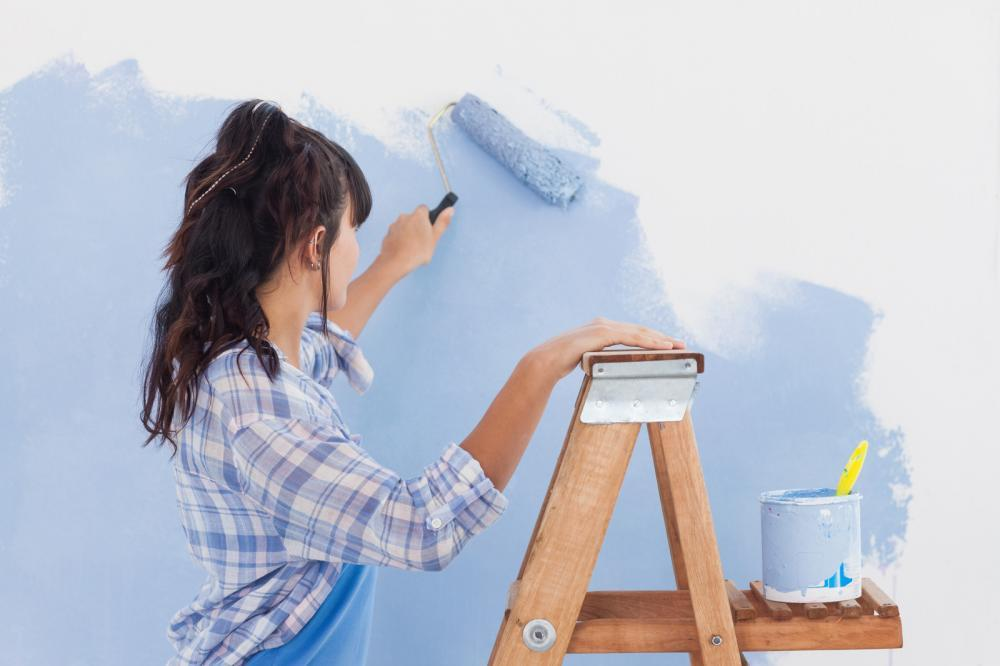 http://streaming.yayimages.com/images/photographer/wavebreakmedia/1b6c9a48174b169126ef37cd7bf167ef/woman-using-paint-roller-to-paint-wall.jpg