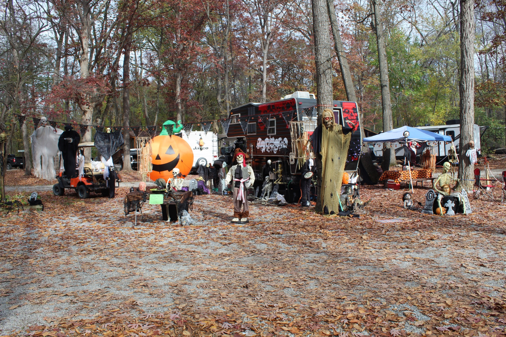 Campground decorated or halloween with large pumpkin