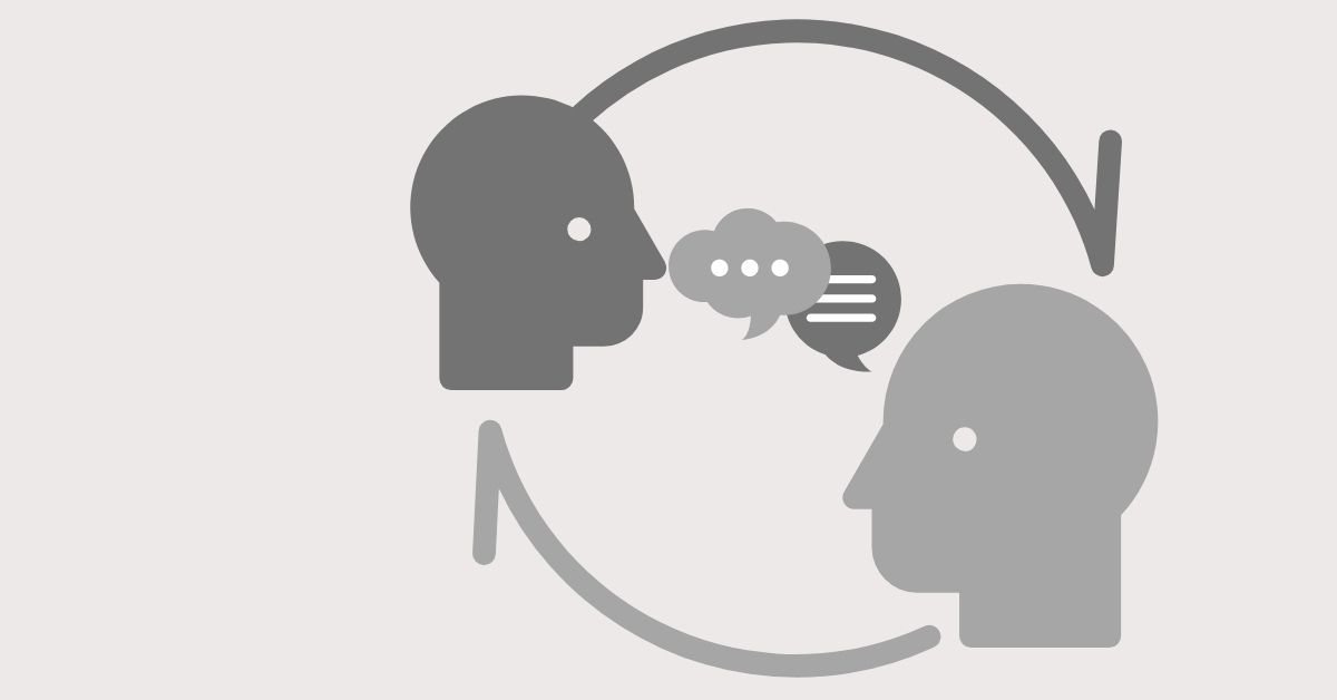 Two human heads connected by thought and speech bubbles.
