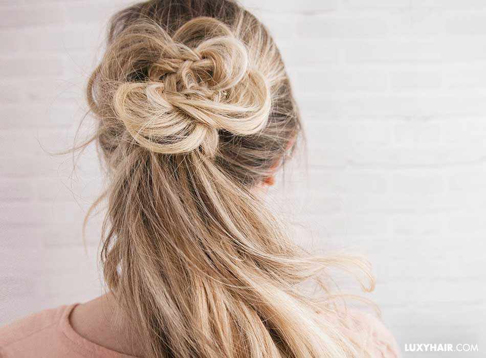 Partial hair in a ponytail with the hair decorating it like a flower
