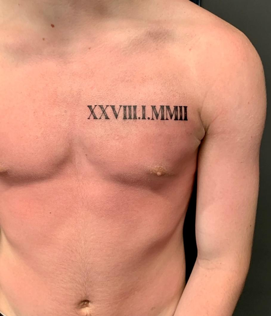 A person wearing a tattoo  Description automatically generated