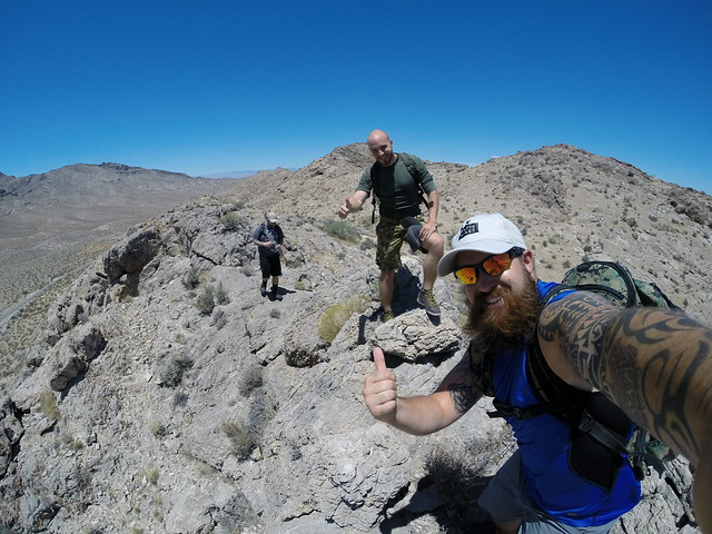 Men in their prime hiking on dry hot mountains.