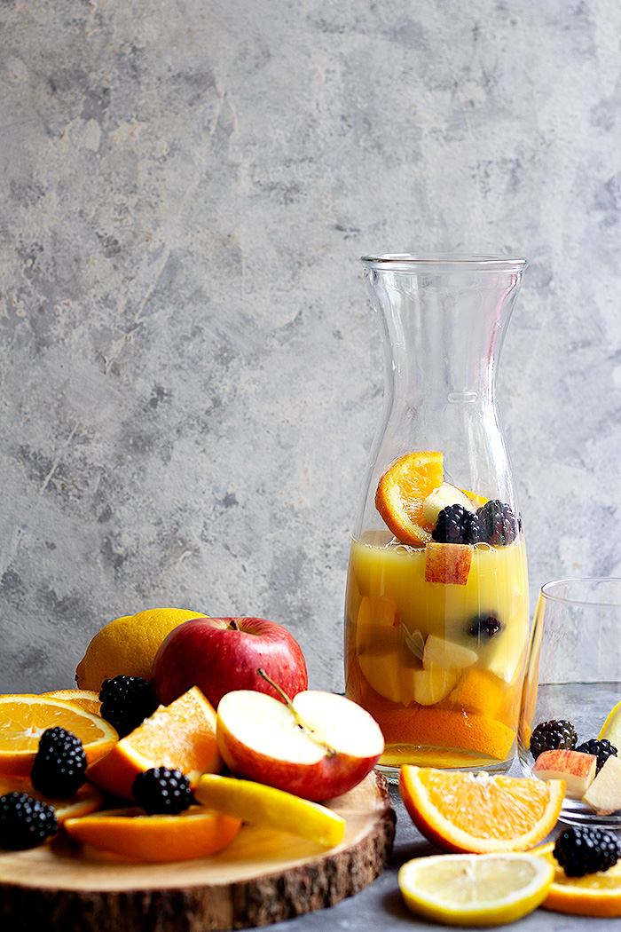 Cut up the fruit and add it to a pitcher. Add orange juice to the pitcher.