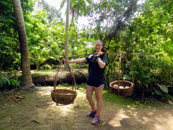 Tera Wilson smiling while interning at EarthRights International in Thailand