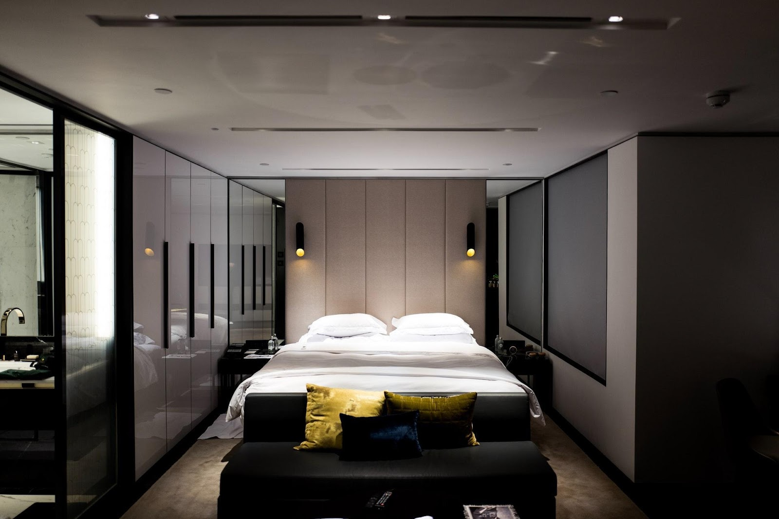 A bedroom with dimmed lights.