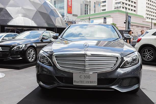 Mercedes-Benz C 300 Bangkok, Thailand - September 26, 2015: Mercedes-Benz C 300 BlueTEC HYBRID presented on Mercedes-Benz Star Dome display at Central World. mercedes benz c 300 stock pictures, royalty-free photos & images
