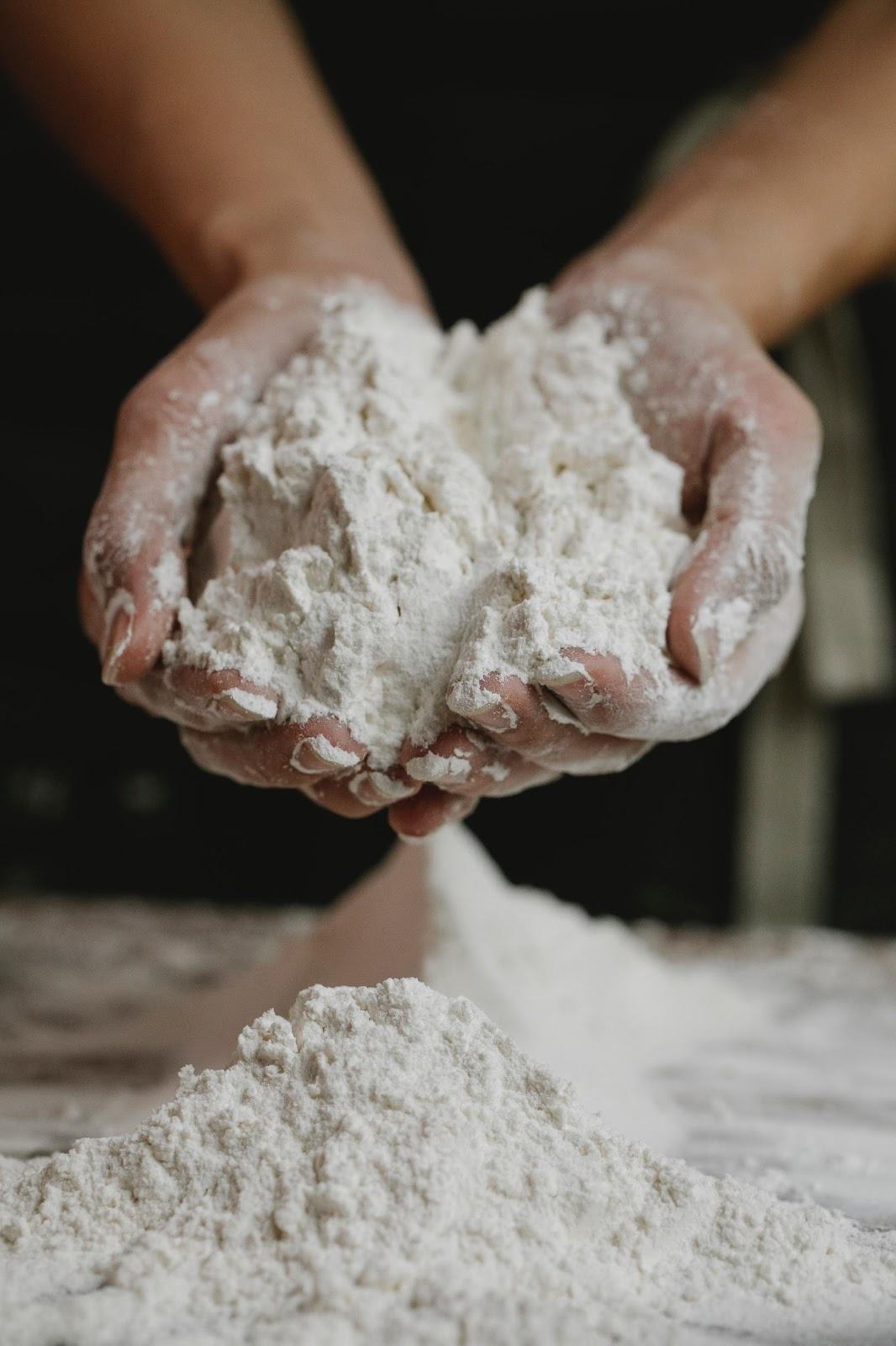 a manufacturer with flour in their hands