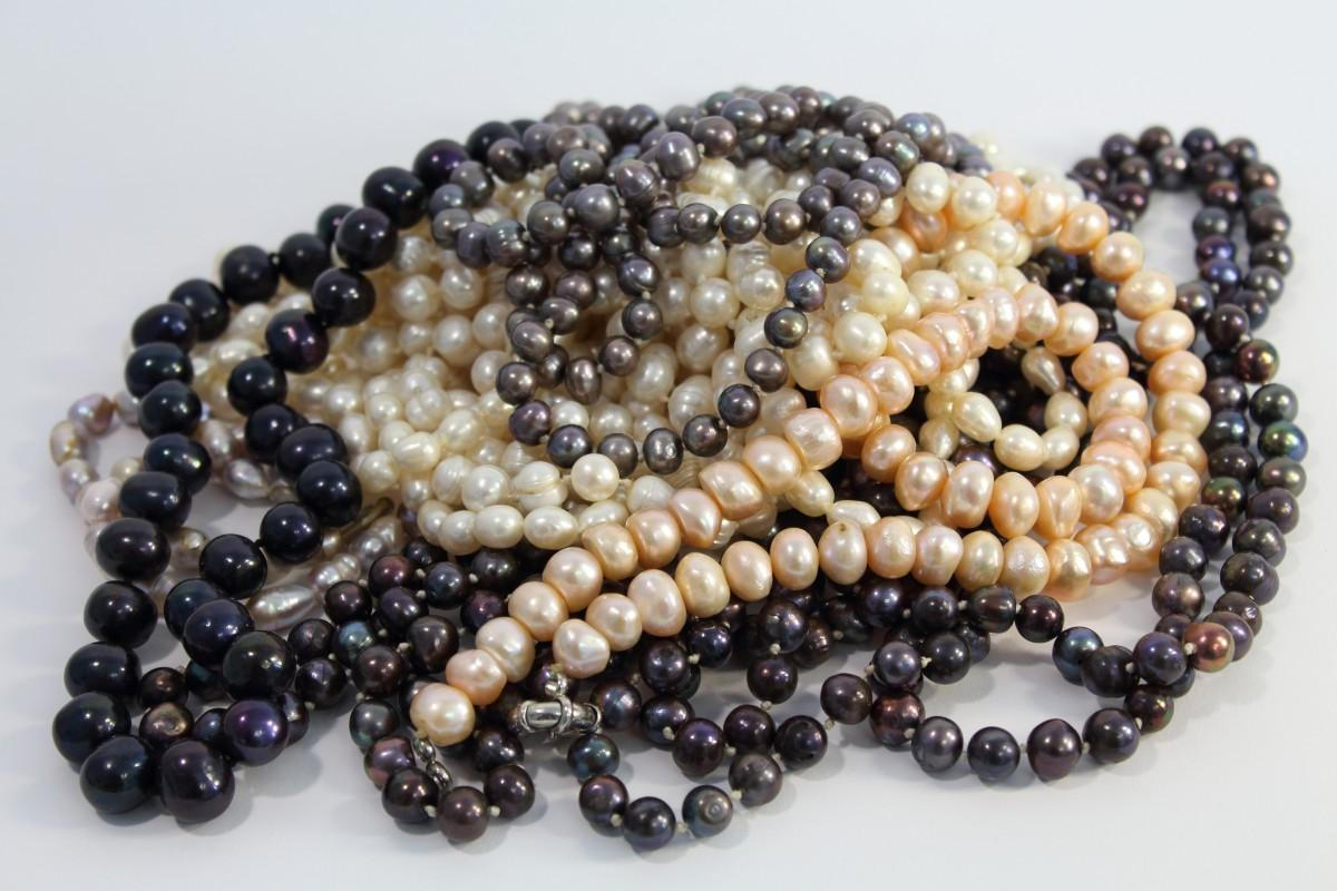 Beads in pink, white, black, lead, and gray
