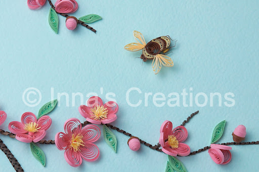 For this picture I used both home-cut and precut quilling strips. My