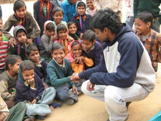 SAP_School_Kids_With_NIRMAAN_Volunteer,_NIRMAAN_Pilani.jpg
