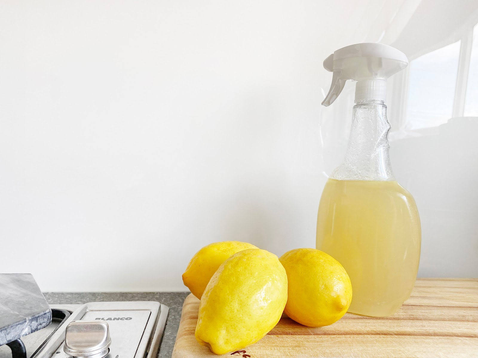a picture of lemon juice in a spray bottle to be used as an all purpose cleaner