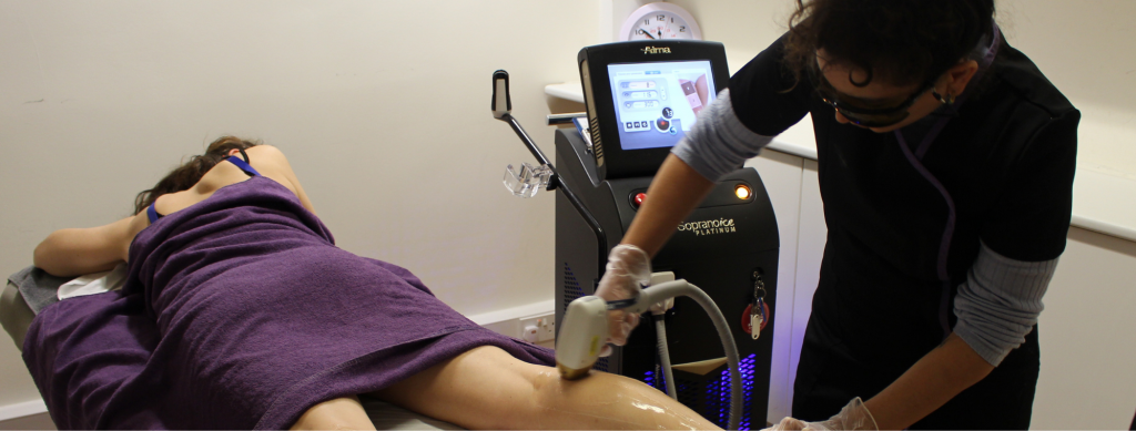 Student performing laser therapy on another student as a part of the Level 4 qualification at The London School of Beauty and Make-Up.