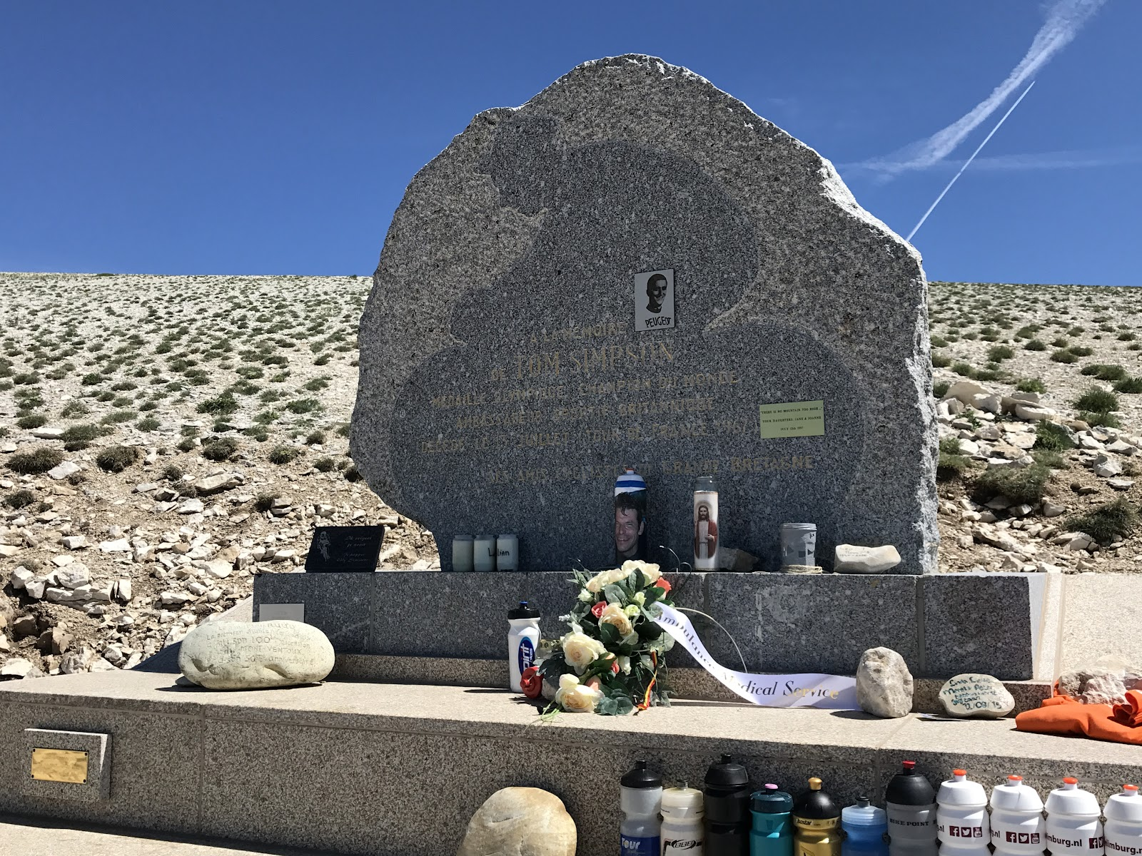 Climb Mont Ventoux by bicycle - Tom Simpson Memorial - water bottles and flowers