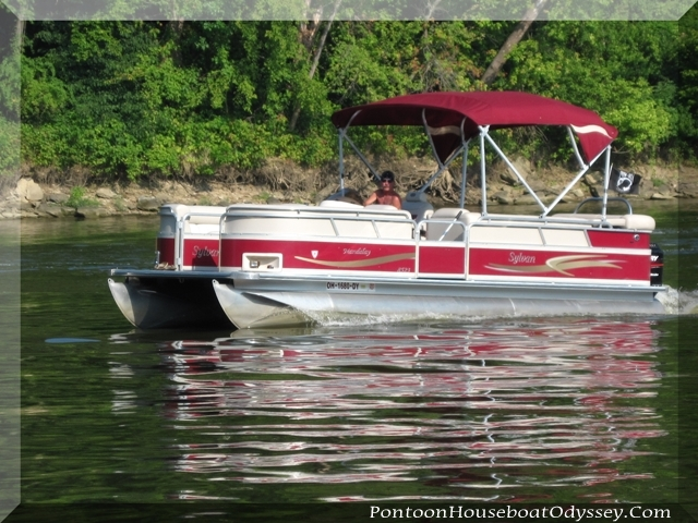 A sharp looking Sylvan pontoon boat cruising the Muskingum River, in Ohio.