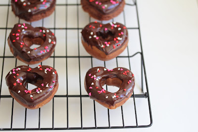 photo of chocolate donuts on a baking rack